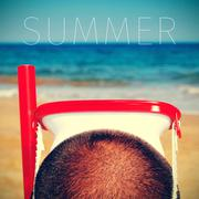 man with a diving mask and the word summer - stock photo