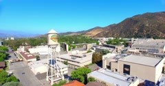 4K, Aerial view of Warner Brothers Movie Studios and Water Tower in Burbank Stock Footage
