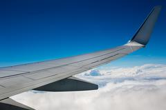 Airplane wing on sky background Stock Photos