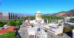 4K, Aerial view of Warner Brothers Movie Studios and Water Tower in Burbank - stock footage