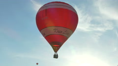 Red-white balloon in the sky Stock Footage