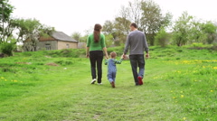 young family on the meadow at sunny day - stock footage