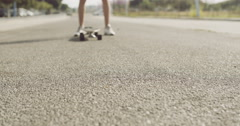 Stock Video Footage of Longboard on the Ground In Front of a Skater Man