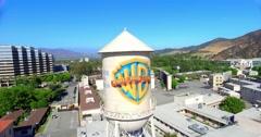 Aerial view of Warner Brothers Movie Studios and Water Tower in Burbank Stock Footage