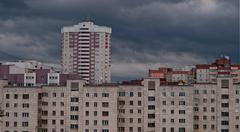 Gray clouds over the urban landscape Stock Photos