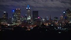 Clouds Drift past City at Night Stock Footage
