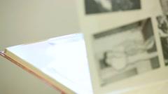 Flipping Through A Photo Album - stock footage