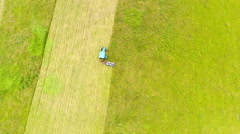 Aerial footage of a tractor mowing hay in a field in Central Kentucky Stock Footage