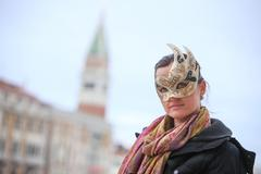 Woman with carneval mask - stock photo
