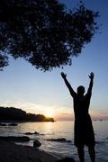 Man saluting sun at Adriatic sea Stock Photos