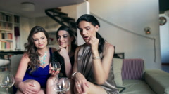 Girlfriends receiving good news at the party, steadycam shot Stock Footage
