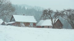 A house in a snow blizzard, in the mountains - stock footage
