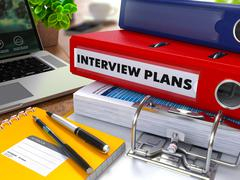 Red Ring Binder with Inscription Interview Plans Piirros