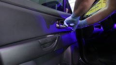 Car service station: dismantling the car door for the creation soundproofing Stock Footage