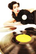 Girl with phonography analogue records music lover - stock photo