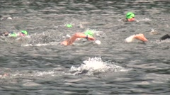 Triathlon Swimmers In Lake zoom out Stock Footage