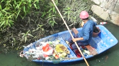 Sanitation workers to clean up the garbage in the river pollution Stock Footage