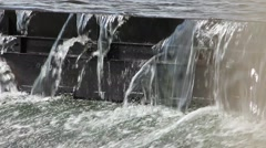 Water Spilling over Dam Closeup Stock Footage