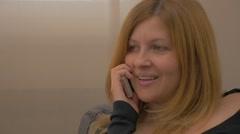 Blond woman  talking on phone FullHD  1080p UHD  slow motion footage -  Femal Stock Footage