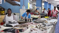 A fishmonger selling fresh fish at a wet market Stock Footage