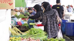 Malaysians of all races shopping at a wet and dry market Stock Footage