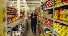 An attractive woman inspecting product in a plastics manufacturing plant Stock Footage
