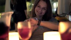 Pretty woman with smartwatch drinking wine in bar at nightHD Stock Footage