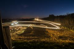 Large tractor light streak Stock Photos