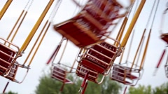 Flying swings in amusement park Stock Footage