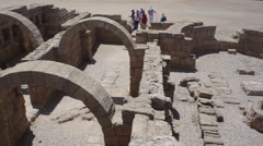 Fly over archeological ruins of ancient Roman city of Caesarea - stock footage