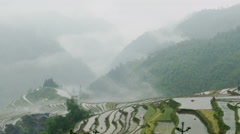 Terraced Rice Field and Mountain Range in the Fog Stock Footage