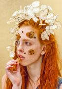 Beautiful ginger girl with flowers in hair. Clean skin - stock photo