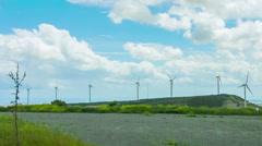 Stock Video Footage of Wind turbines rotating, generating renewable energy. Innovative technologies