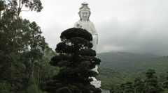 Hyperlapse video of Giant bronze-cast white Guan Yin - stock footage