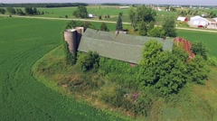Scenic View of Abandoned Rustic Barn and Silos Stock Footage