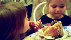 Group of two children cute fashion little girls eat happy birthday  cupcake Stock Footage