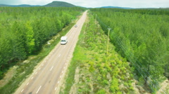 Aerial drone shot of a road with camper Stock Footage