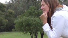 Stressed depressed mature woman outdoor Stock Footage