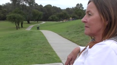 Lonely stressed senior woman outdoor Stock Footage