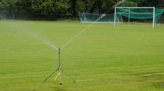 Sprinklers on the football pitch. Stock Footage
