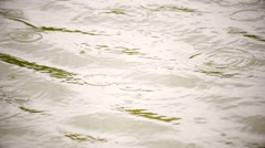 Amazing slow motion of rain dropping on the sepia water surface. Stock Footage