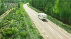 Aerial drone shot of a camper in forest - stock footage