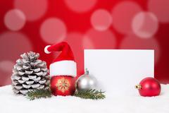 Merry Christmas card with snow, ornaments, balls, hat decoration and copyspac - stock photo