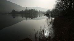 Still, dark waters with reflections on Lake Windermere, Lake District, Cumbria Stock Footage