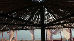 Lovely beach with thatched umbrella  and pavilion for relax, Slow Motion Stock Footage