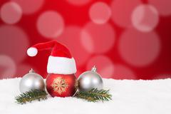 Christmas card hat red background with copyspace Stock Photos