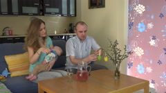 Happy family with baby sleeping prepare Easter decorations. 4K Stock Footage