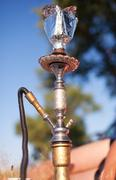 Close-up photo of foil for hookah on nature background Stock Photos