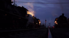steam trains in dispatching yard at night - stock footage