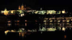 Reflection of Prague caste and the Charles bridge at dusk Stock Footage